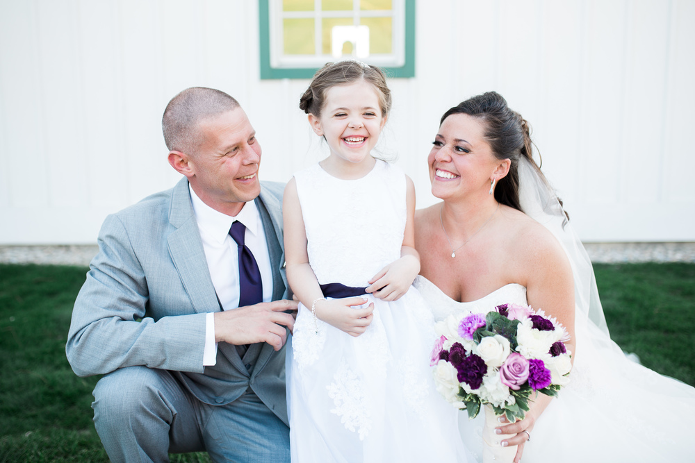 Bride and groom with his daughter
