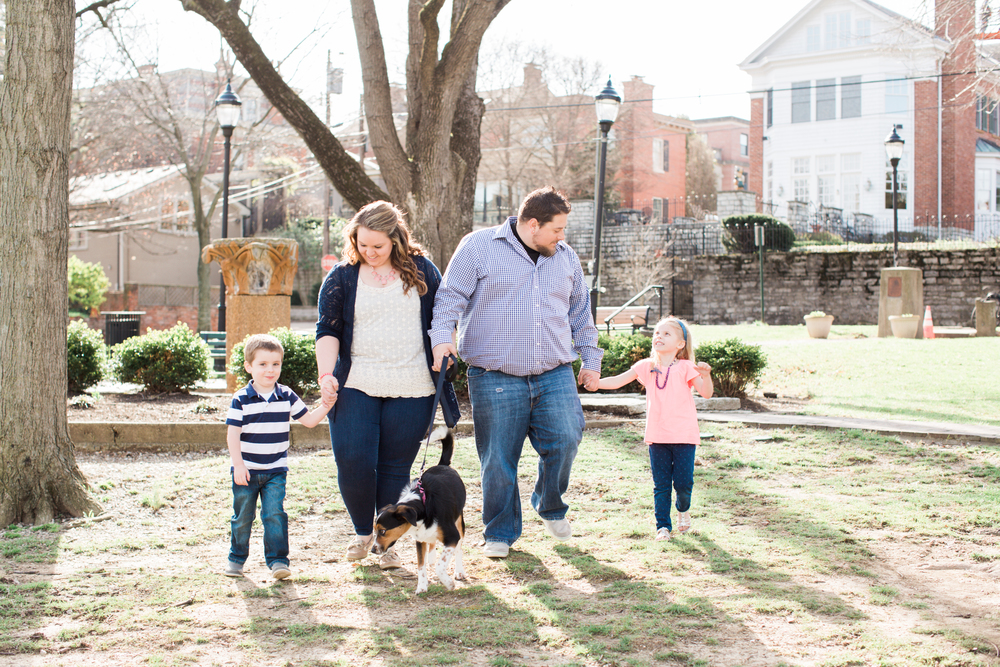 family walking in the park in riverside district covington
