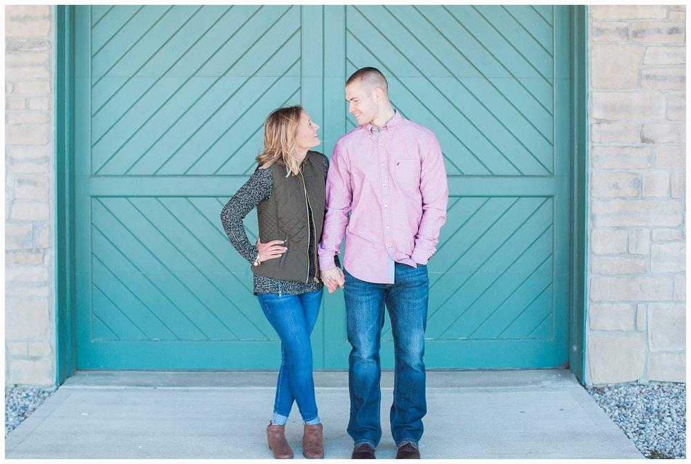 couple in front of teal door in west chester ohio