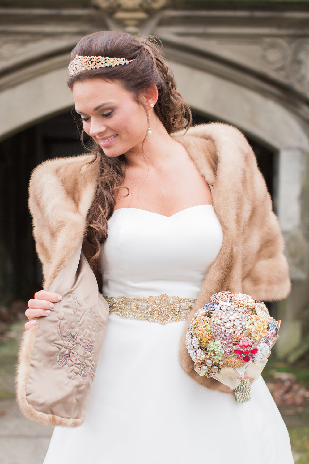 Sarah chose to wear her grandmothers mink fur coat for part of the day. She didn't know her grandmothers initials were beautifully embroidered inside until the day of. It was almost like she was meant to find it on the day of her wedding as if it was a sign from God to say don't worry she loves you. It still gives me chills to think about! Her bouquet was carefully put together and made up of all of her grandmothers and great grandmothers brooches. You can tell Sarah is an old soul and sentimental and did everything she could to incorporate those she loved.
