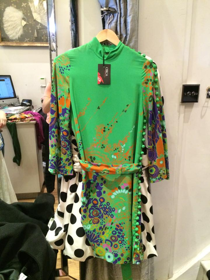 Green Printed Dress with Covered Buttons Psychedelic prints are a trademark of the swinging sixties and were traded in the boutiqeus of Carnaby Street. Heavily associated with designers such as Emilio Pucci.