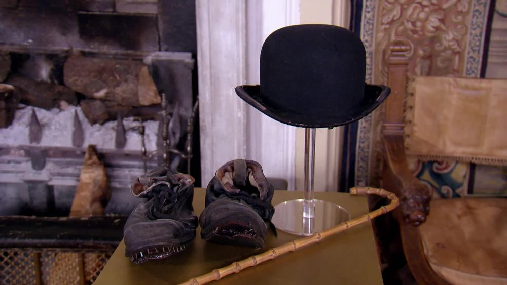 "Charlie Chaplin Hat, Shoes and Cane. Part of the costume from Chaplin's first ever performance of the iconic ""The Tramp"" routine. Entire costume is currently on sale for £115,000. £80,000 