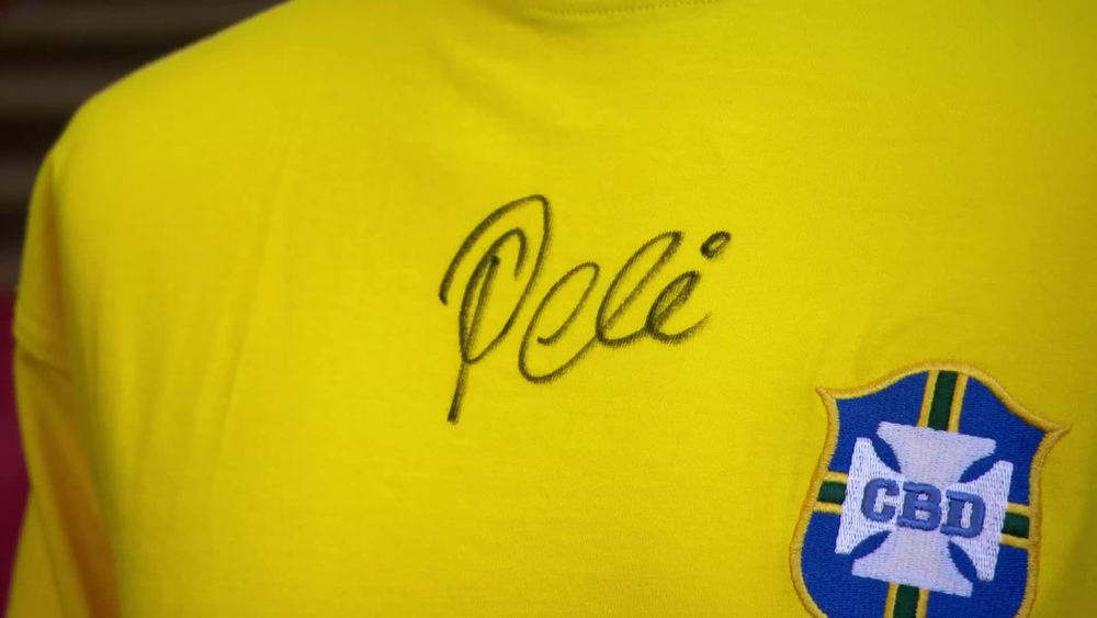 Replica Pele signed shirt. £120 | Bloomsbury Auctions | www.frasersautographs.com