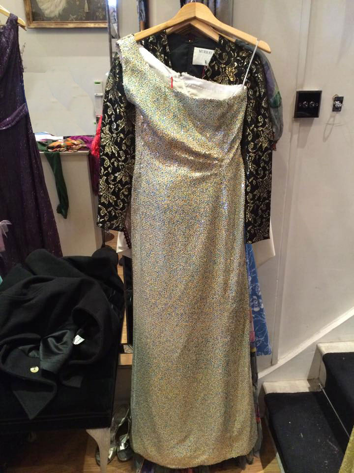 Andre Lang sequin one shoulder dress This dress is a classic example of disco style which featured cinched waists, sequins and manmade materials, all designed to sparkle under the lights at nightclubs.