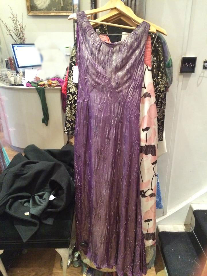 Purple and gold Lame dress This dress is an example of lamé fabric, which is made from metallic yarns woven into the cloth.