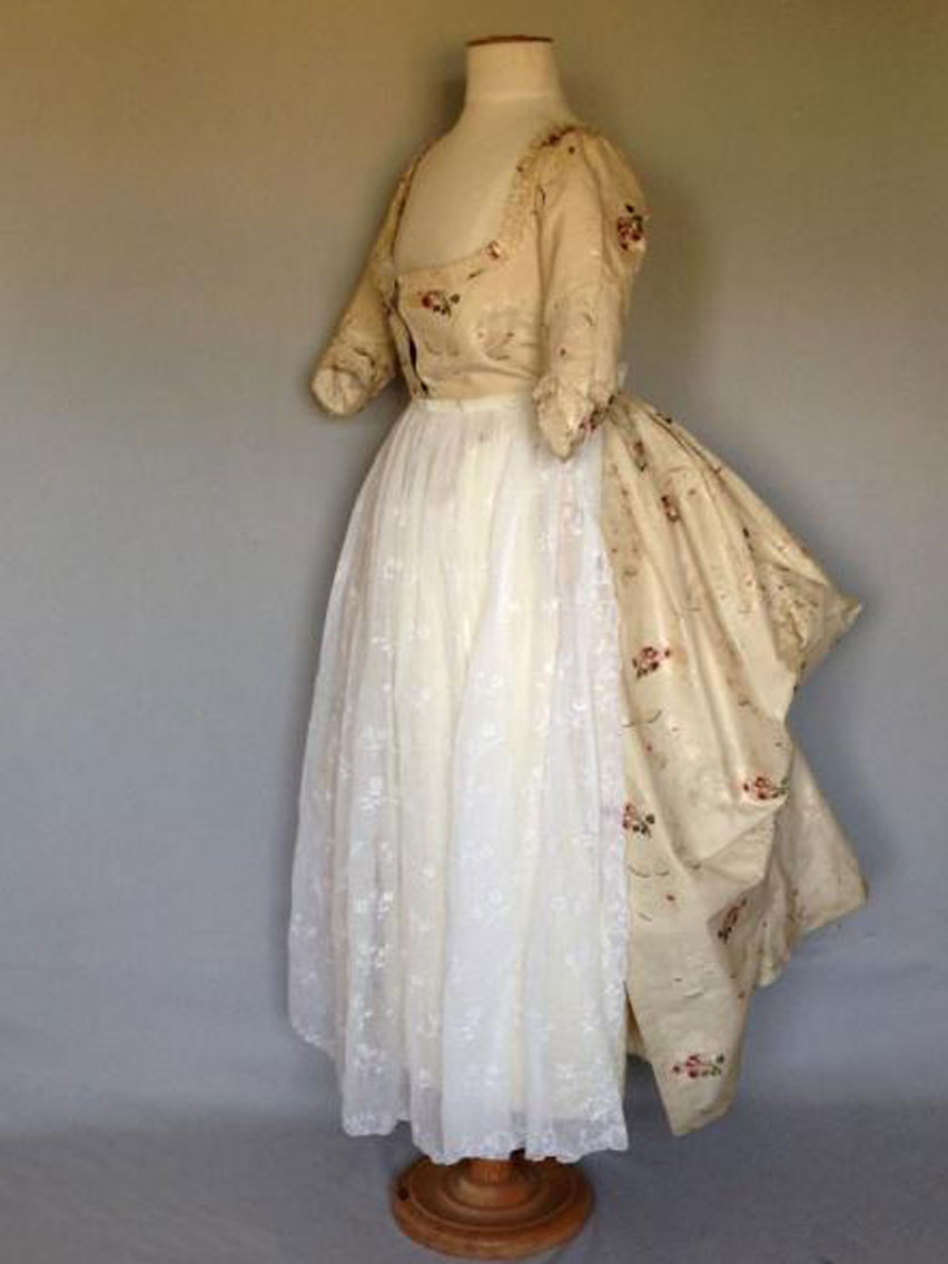 1780s's. Made of woven brockade - weaved in Spitalfields market. Hand woven flowers signify a wealthy woman would have worn