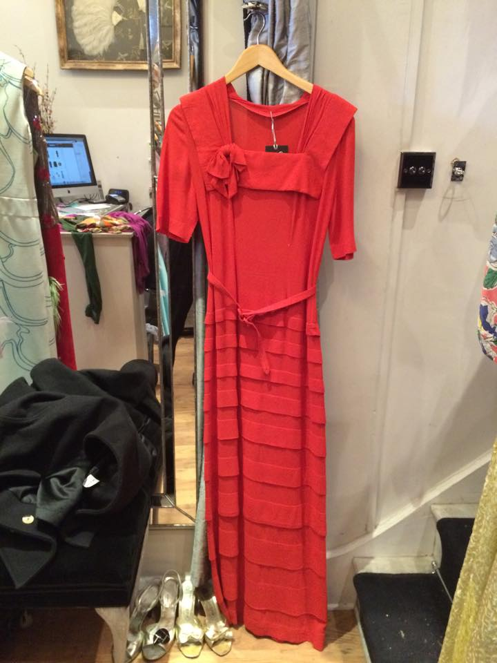 1940's. Full length coral red dress 'Decoesque' detailing, square neckline, crepe, metal zip and unlined.