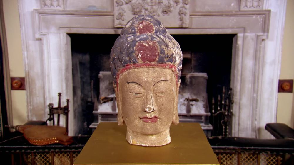 Painted and carved wooden head of Buddha. £150 | Private Collection