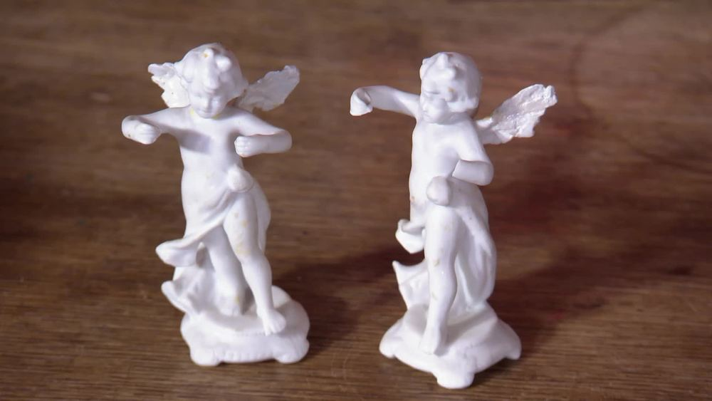 Pair of white cherubs from the Queen's Christening cake. £1280 | Sophie Dupre | www.sophiedupre.com