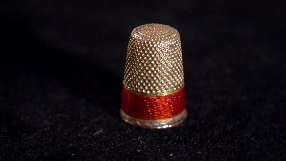 14 carat gold and red enamel Thimble by Faberge, makers mark Henrik Wigstrom circa 1906- 1917. £10,000 | Sutton and Roberts | www.suttonsandrobertsons.com
