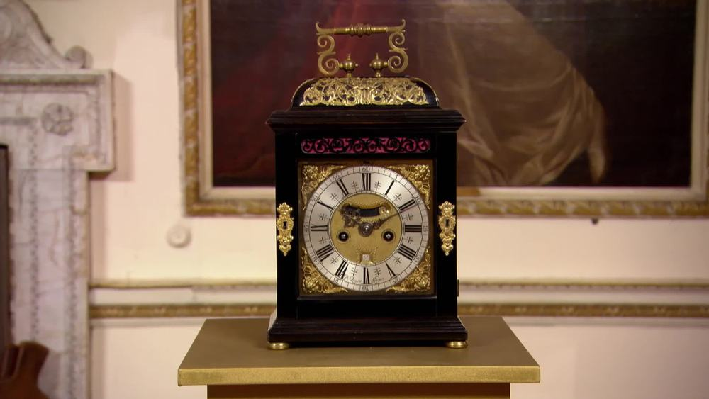 An imposing 1865 William and Mary spring table clock by Daniel Quare. The ebony and gilt metal mounted case has typical Quare corner escutcheons and bold carrying handle. The eight-day duration movement with quarter repeating mechanism, verge escapement and a foliage engraved backplate around the maker's signature. £95,000 | Anthony Woodburn | http://www.anthonywoodburn.com/