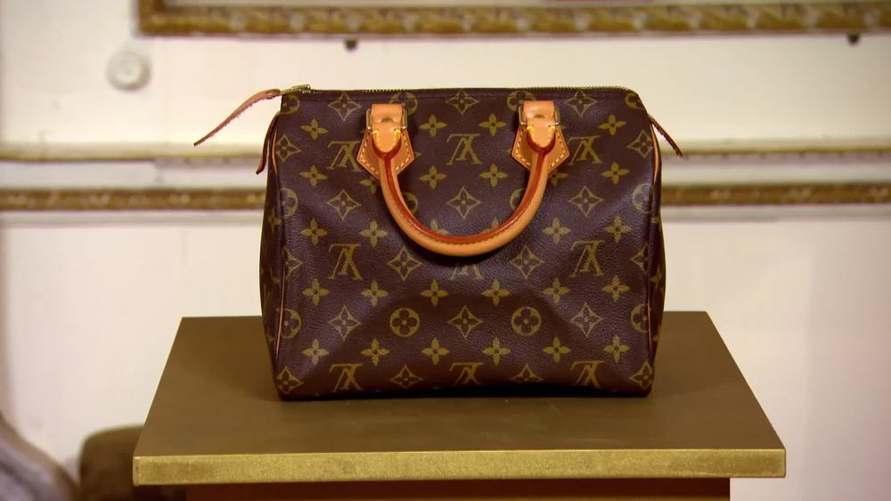 A 1995 Ladies Louis Vuitton Speedy 25. Brown canvas with gold hardware. £490 | Xupes | www.xupes.com