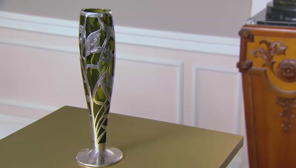Art Nouveau Vase With art Nouveau glass it's all about the maker and this is unsigned. Beautiful with silver overlay, but the lack of maker's mark limits its value. Price: £1,650 Visit Hickmet Fine Arts website