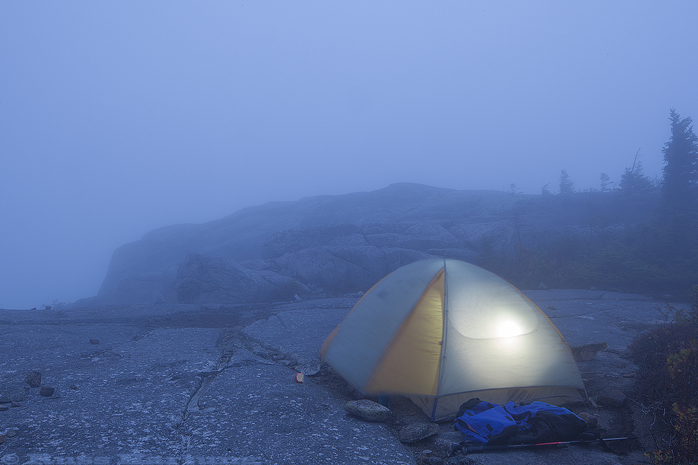 I spent the night on a ridge off the trail so I could do some sunrise photography. Instead I woke up to wind and thick fog.