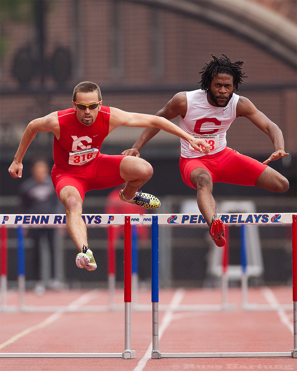 These hurdlers seem to be synchronized at the Penn Relays.
