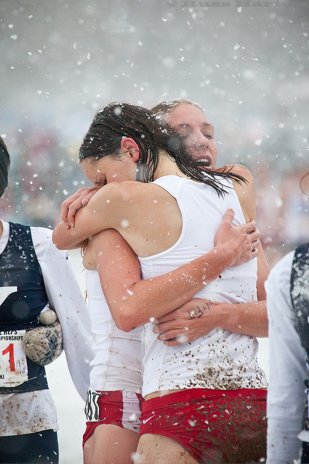 Warriors' embrace after a valiant and winning effort (in a freak October snowstorm) at the 2011 Heptagonal Cross-Country Championsips in Princeton.