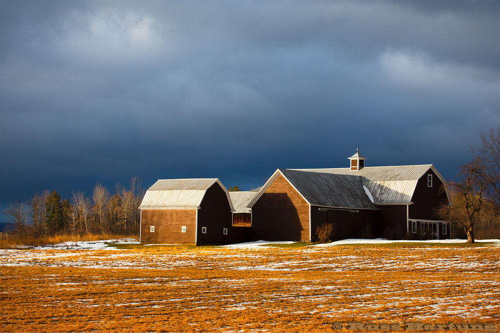 Sunrise highlights this barn in Plattsburgh, New York while the sky was still dark from a passing storm.