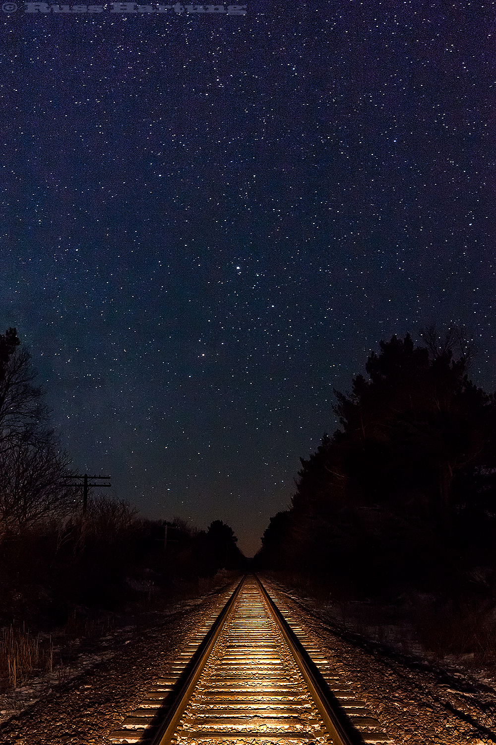 Train tracks at night.
