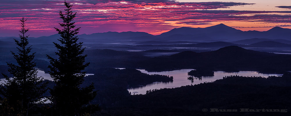 View over the St. Regis Canoe Wilderness from the top of St. Regis mountain at sunrise.