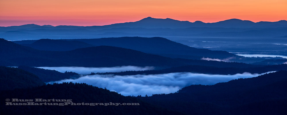 Fog in the valleys at dawn looking East from Pharoah Mountain.