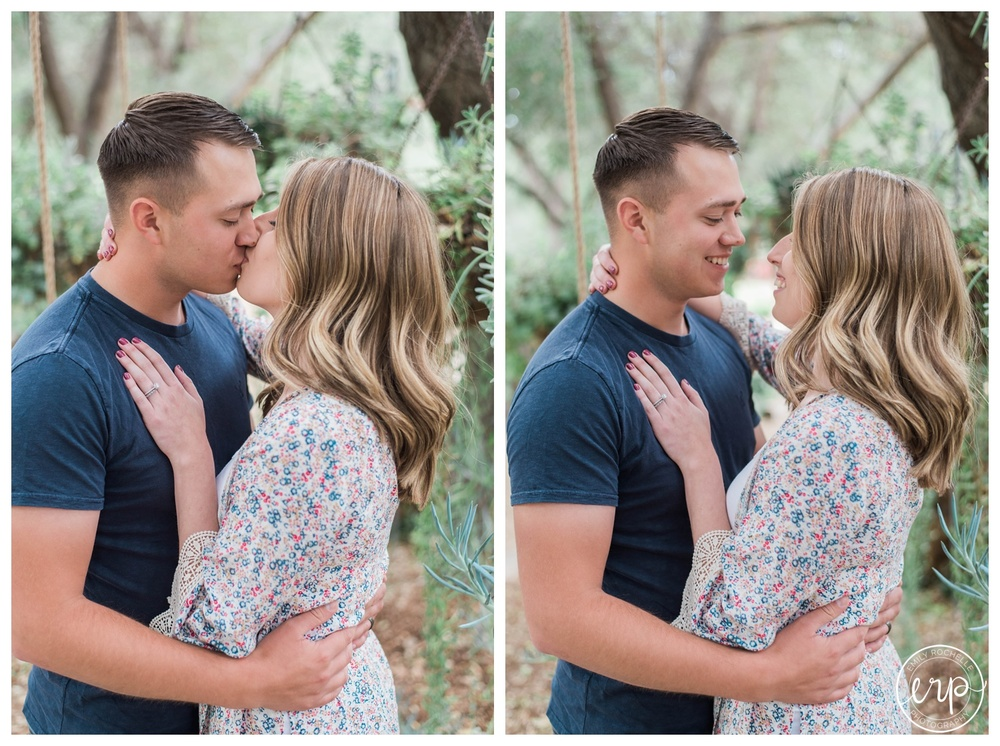 Couple during engagement session at Myrtle Creek kissing and smiling at each other.