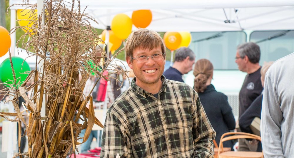 Ben at open air market. Smiling is necessary! Positive attitude and outgoing.  Engaging our customers with information about our farm.