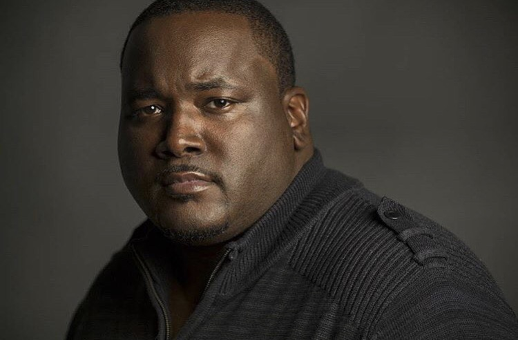Photography headshot of Quinton Aaron.