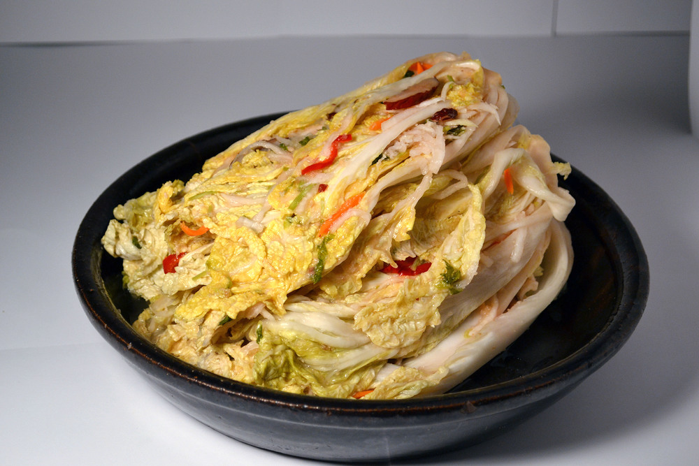 WHITE KIMCHI: This is a non-spicy Napa cabbage Kimchi. Not only does it contain the most ingredients, it is one the healthiest. For those who want a calming touch to their taste buds, this is for you.