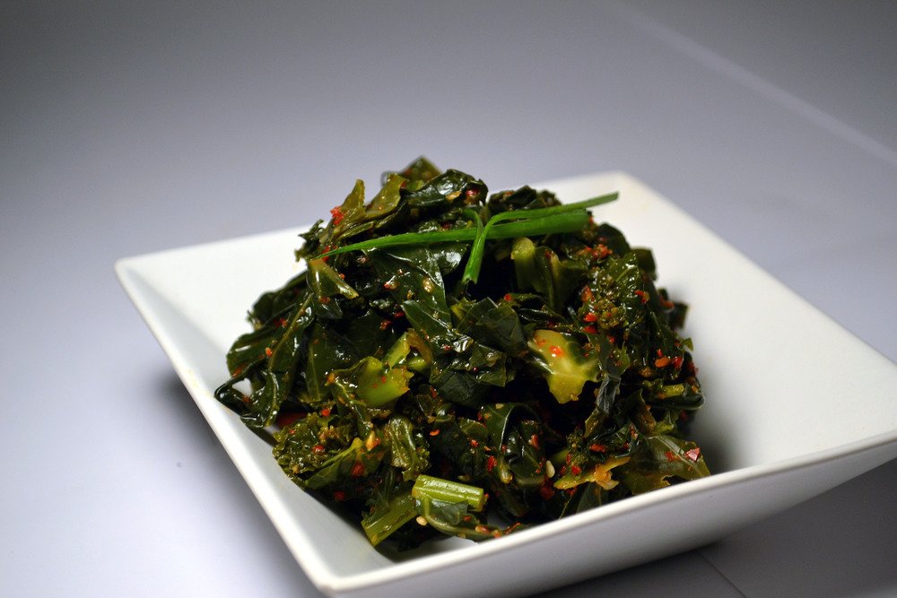 KALE KIMCHI: One of the densest and nutrient packed vegetables, Kale Kimchi is a super food. We pulverize the hard middle stem and mix it in the sauce, to make sure you get your fiber!
