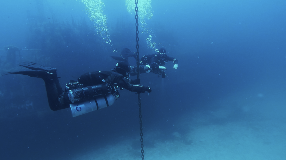 Tech Sidemount Divers during a staged decompression ascent