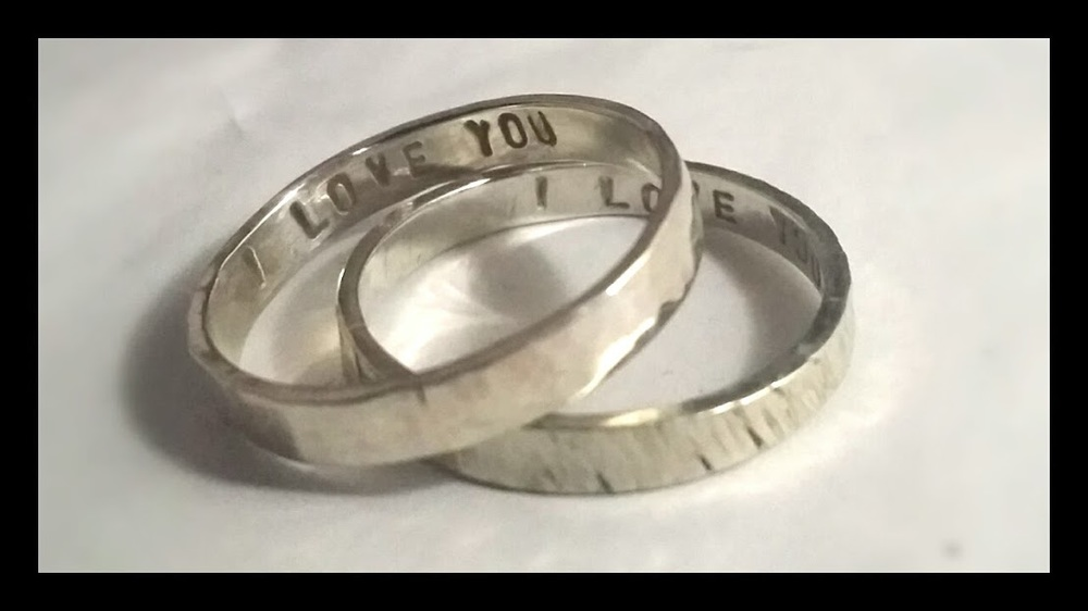"Textured sterling silver rings with ""I Love You"" inscription"