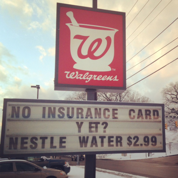 Image: A sign outside a Wallgreen's Pharmacy  outside of Charleston, WV in January 2014, at the beginning of the Medicaid expansion and at the height of the West Virginia Water Crisis, when the drinking water of 300,000 people was poisoned by a chemical spill.