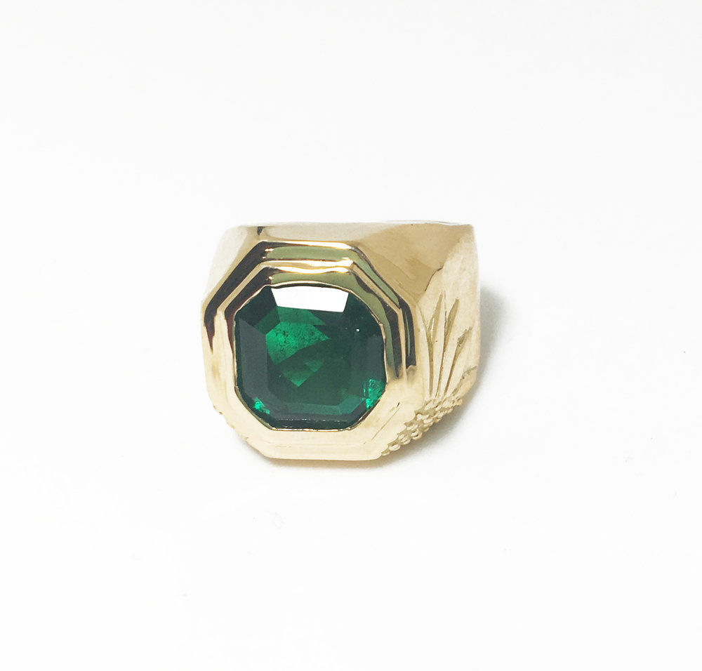 Post consumer emerald set in 18k gold.