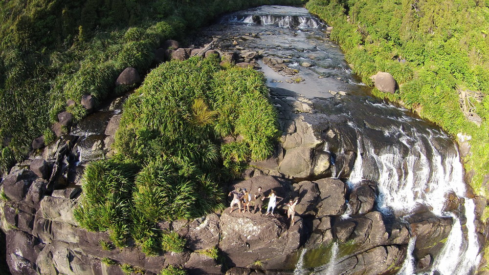 Dancing on the top of Wairere Falls after nailing the shot. Philipe is flying the drone.