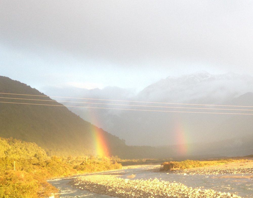 Double rainbow between Hokatika and Fox Glacier illustrating the spectrum of light that is either absorbed or reflected off matter depending on its frequency.