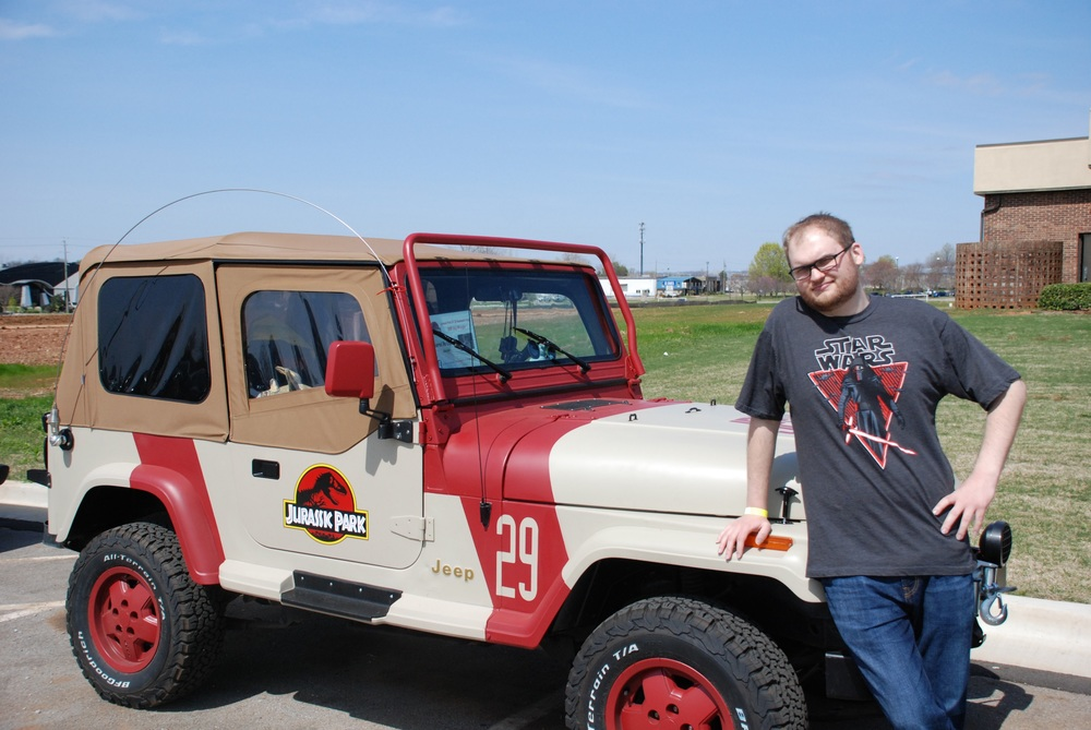 Seth spends some quality time near the Jurassic Park jeeps...