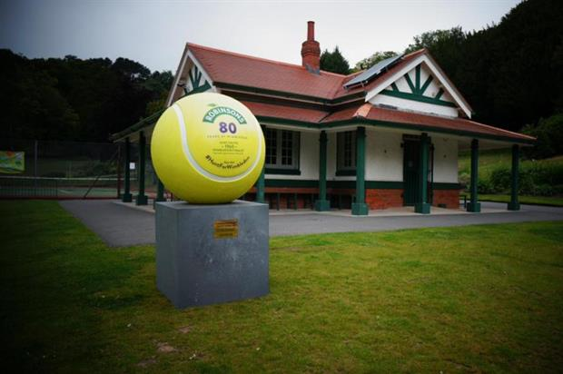 One of Robinson's 'hidden tennis balls' located in Swansea. Credit: @DrinkRobinsons