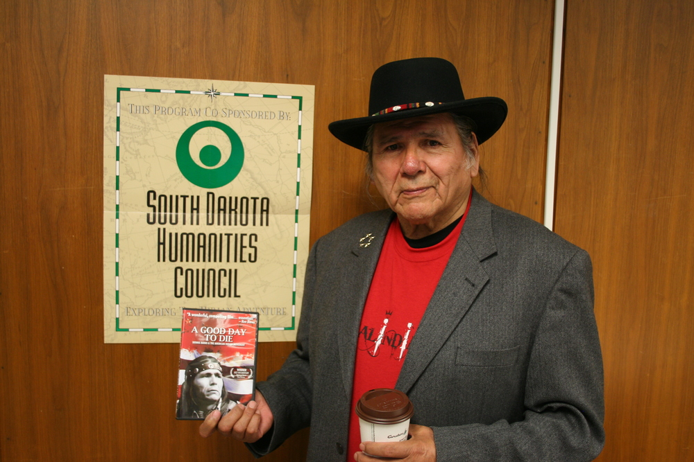 Dennis Banks holding a copy of the new documentary film about his life entitled  A Good Day to Die: The Movement that Started a Revolution and Inspired a Nation.