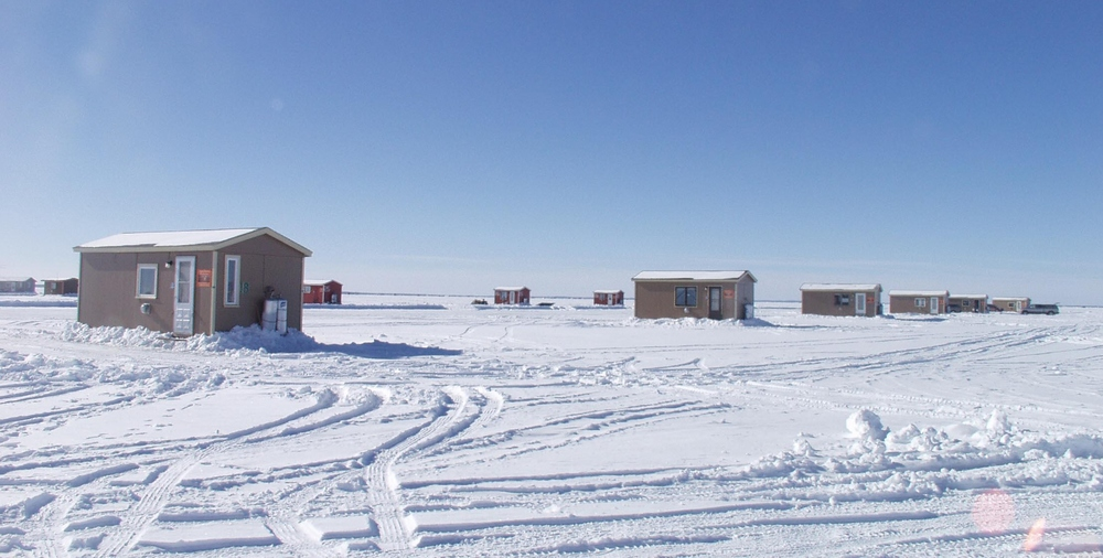 Fish houses on Mille Lacs Lake. Must be early in the season because there aren't very many on the ice yet.