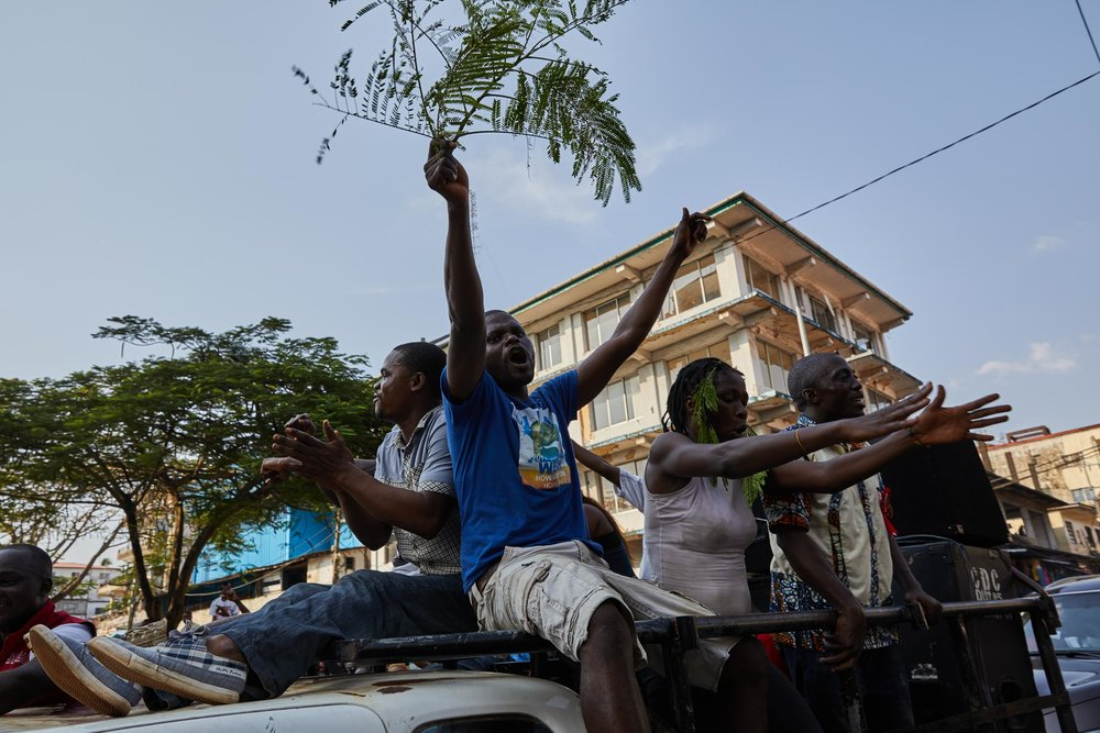 Supporters of George Weah celebrate in the streets of downtown Monrovia.