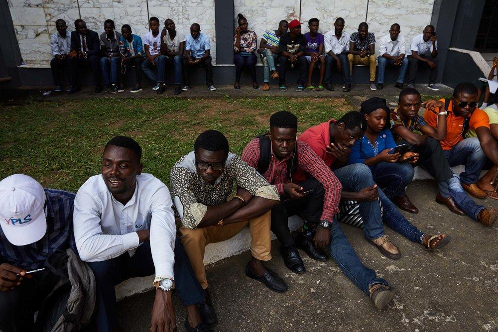 Young Liberians await news of a court decision regarding election delays.