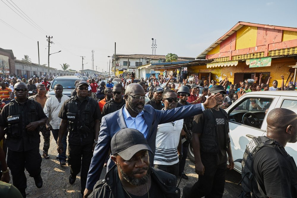 George Weah campaigning in the streets of Monrovia before his successful electoral win.