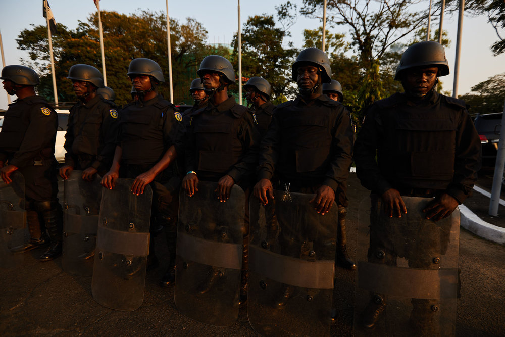 Liberian police forces await orders.
