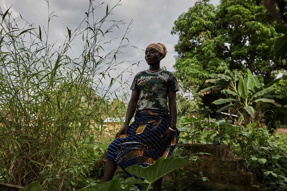 Mae-Jean Singbe lost 3 members of her family in Mawah during the Ebola crisis, her daughter, father and uncle. She lacks the means to move away and works as a gardener and a trader.