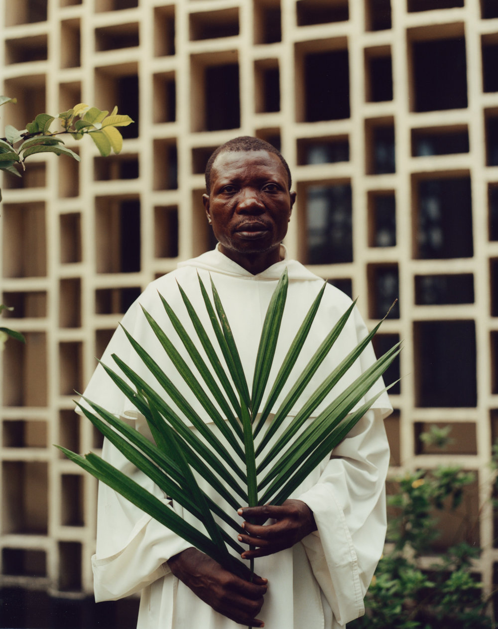 """Père Jean Nkongola, La Paroisse St. Dominique, Limete, Kinshasa.  """"We want to see change. We know that an election can bring peace to the country""""."""
