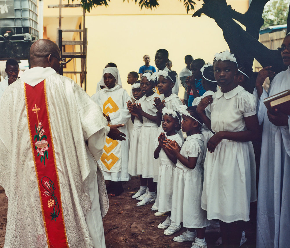Ngonga Ebeti, Tango Ekoki   A priest blesses acolytes and choirgirls after Sunday service at St. Benoit, Lemba, Kinshasa. The site of a recent shooting during anti-government protests.