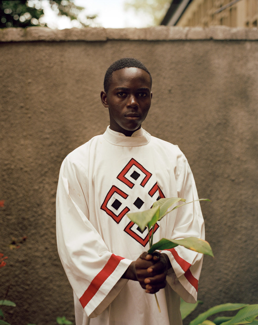 Acolyte Frederick Tshimanga. La Paroisse St. Dominique, Limete, Kinshasa. This church is heavily involved in anti-government activity and a protest march in early 2018 was dispersed with live ammunition and tear gas.