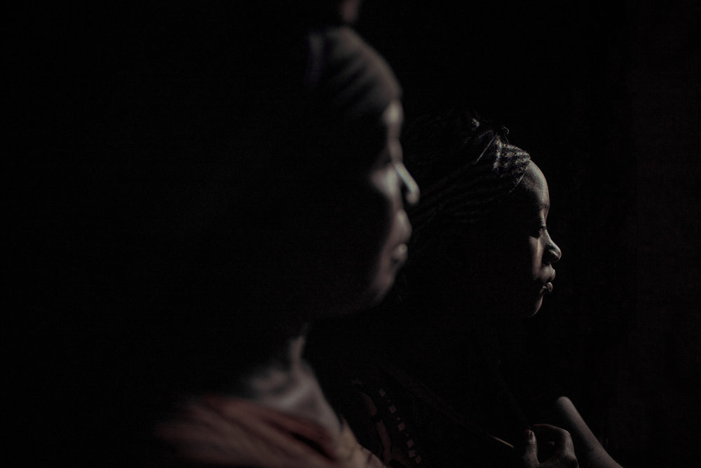 A former child bride at home with her mother in an IDP camp, North Kivu. Young survivors of violence often face stigma and issues reintegrating.