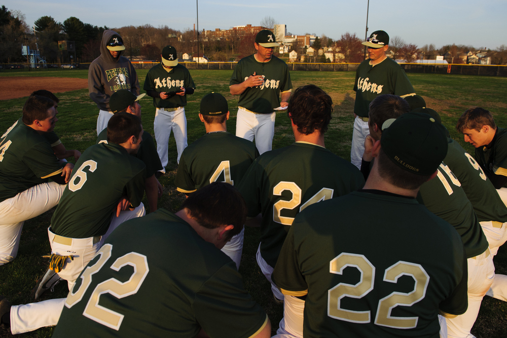 "Head Coach Chris Stewart talks to the team after their 9-5 loss against Marietta. ""There is something called free bases and we gave up too many of them today. Five of them resulted in runs,"" said Stewart. A free base is a base taken as the result of an error. In this game, many of them were wild pitches that went past the catcher."