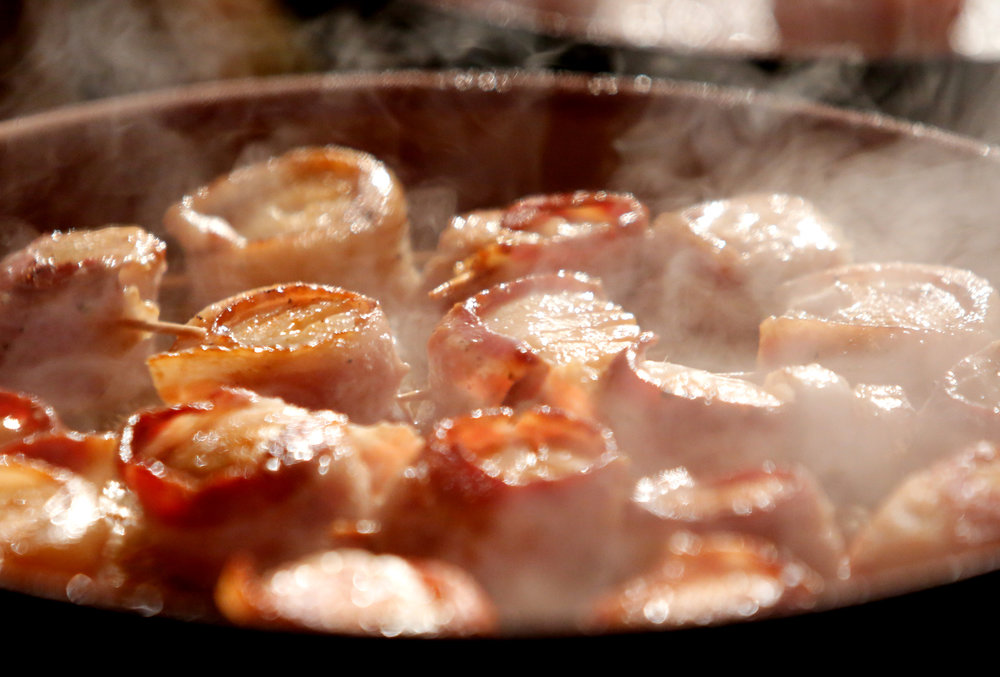 Bacon wrapped scallops during the 2017 Food + Wine opening night at Marion Square in Charleston, S.C.